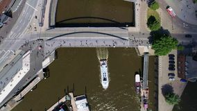 Aerial view of Hamburg, Hafencity Germany. Boat under the bridge on river Elbe stock footage
