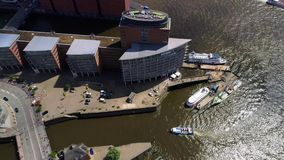 Aerial view of Hamburg, Hafencity Germany. Boat under the bridge on river Elbe stock video