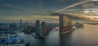 Aerial view of Hamburg at sunrise with a concert hall in the foreground and Speicherstadt/Hafencity stock image