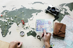 Aerial view of hand holding passport planning the journey with t stock images