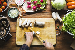 Aerial view of hand with knife cutting mushroom Stock Photography