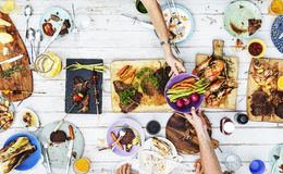 Aerial view of hands sharing food together Stock Photos
