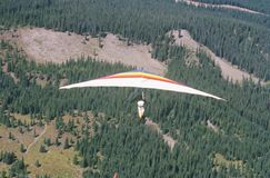 Aerial view of Hang Glider in mid air during Hang Gliding Festival, Telluride, Colorado Royalty Free Stock Photo