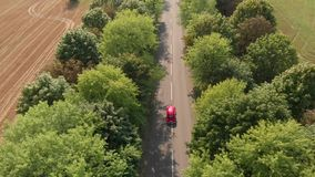Aerial view of happy couple driving vintage convertible car down stock video