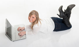 Aerial view of happy girl using laptop on the floor Royalty Free Stock Image