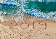 Aerial view, Happy New Year 2019. With the perfect waves washing on the beach vector illustration
