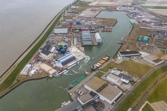 Aerial view harbor Harlingen, Dutch village at Wadden Sea. Aerial view harbor and industrial park Harlingen, Dutch village at Wadden Sea stock image