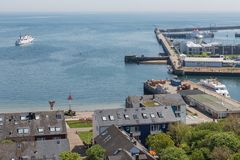 Aerial view harbor and houses of village German island Helgoland. Aerial view harbor and houses of village at German island Helgoland royalty free stock image