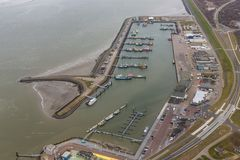 Aerial view harbor Lauwersoog at Dutch coast Wadden Sea royalty free stock photo