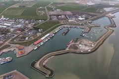 Aerial view harbor Oudeschild at Dutch island Texel. In Wadden sea stock photo