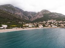 Aerial view Harbour and small town at Boka Kotor bay (Boka Kotorska), Montenegro, Europe. Building landmark boat mountain rock tourism travel royalty free stock photography