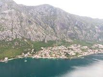 Aerial view Harbour and small town at Boka Kotor bay & x28;Boka Kotorska& x29;, Montenegro, Europe. Building landmark boat mountain rock tourism travel royalty free stock image