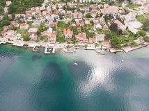 Aerial view Harbour and small town at Boka Kotor bay & x28;Boka Kotorska& x29;, Montenegro, Europe. Building landmark boat mountain rock tourism travel royalty free stock photography