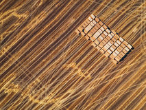 Aerial view of harvest field and hay bales.  Stock Photo