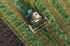 Aerial view of harvest fields with combine Royalty Free Stock Images