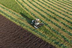 Aerial view of harvest fields with combine Stock Images