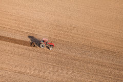 Aerial view of harvest fields with tractor Royalty Free Stock Photography