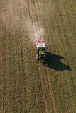 Aerial view of harvest fields with tractor. In Poland Royalty Free Stock Photo