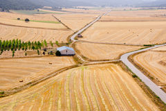 Aerial view of harvested wheat fields and farm Royalty Free Stock Photos