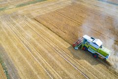 Aerial view of harvester combine working on field Stock Photo