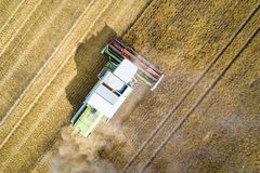 Aerial view of harvester combine working on field Stock Photos