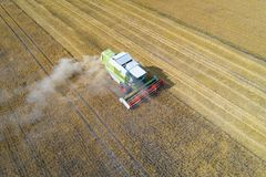 Aerial view of harvester combine working on field Royalty Free Stock Image