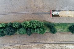 Harvester working on the wheat field. Aerial view on the harvester working on the wheat field Royalty Free Stock Images