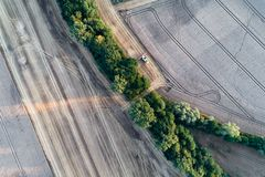 Harvester working on the wheat field. Aerial view on the harvester working on the wheat field Royalty Free Stock Photography