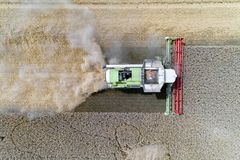 Harvester working on the wheat field. Aerial view on the harvester working on the wheat field Royalty Free Stock Photos