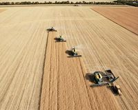 Aerial View of Harvesters in Formation Royalty Free Stock Image