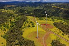 Aerial view of fields and palm trees in Oahu Hawaii. Aerial view of Hawaiian landscape with wind turbines in Oahu Hawaii from a helicopter Royalty Free Stock Photos