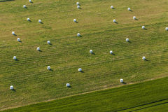 Aerial view of hay bales on the field Stock Photos