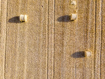 Aerial view on Haystacks on a wheat field during harvest Royalty Free Stock Photo