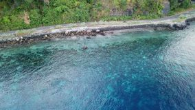 Aerial View of Healthy Reef in Alor, Indonesia. Aerial view of a beautiful coral reef fringing a remote island in Indonesia. This part of the world is home to stock footage