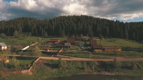 Aerial view from the height of the village near a forest stock footage
