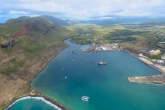 Aerial view from a helicopter over the magnificent blue bay, Lihue, Kauai, Hawaii royalty free stock photography