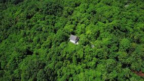 Aerial View of Hermitic House Standing Apart in Remote Isolated Location among Tropical Forest. Shot with a DJI Mavic fps29,97 4k stock video