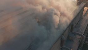 Aerial view. High chimney pipe with grey smoke. Concept of environmental pollution, climate change. stock video
