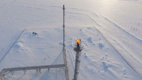 Aerial View High Gas Torch Towers among Snow Valley stock video footage