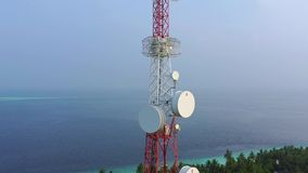 Aerial view of high red and white radio network telecommunication tower