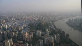 Aerial view of high-rise buildings with river in Shanghai,China,time lapse. stock video