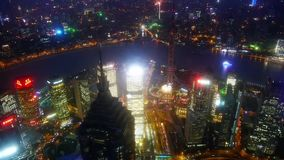 Aerial view of high-rise buildings with river in Shanghai at night,China. stock video footage