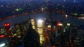 Aerial view of high-rise buildings with river in Shanghai at night,China,time lapse. stock footage