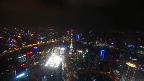 Aerial view of high-rise buildings with river in Shanghai at night,China,time lapse. stock video footage