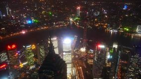 Aerial view of high-rise buildings with river in Shanghai at night,China,time lapse. stock video