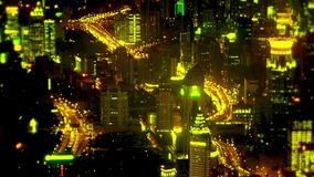 Aerial view of high-rise buildings & urban traffic flow at night,time lapse. stock video