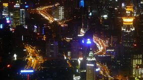 Aerial view of high-rise buildings & urban traffic flow at night,time lapse. stock video footage