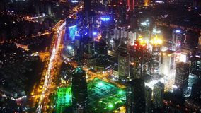 Aerial view of high-rise buildings & urban traffic at night,China,timelapse. Elevated view of urban traffic & brightly lit high-rise buildings at night in stock video