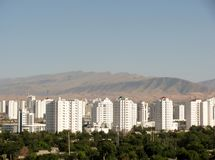 Aerial view of Ashgabat and Kopet Dag mountain range. Turkmenistan. Aerial view of high-rise office buildings residential and Kopet Dag mountain range Ashgabat Stock Photography