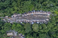 Aerial view of high thatch-roofed houses of traditional Bena village, Flores, Indonesia Royalty Free Stock Photos